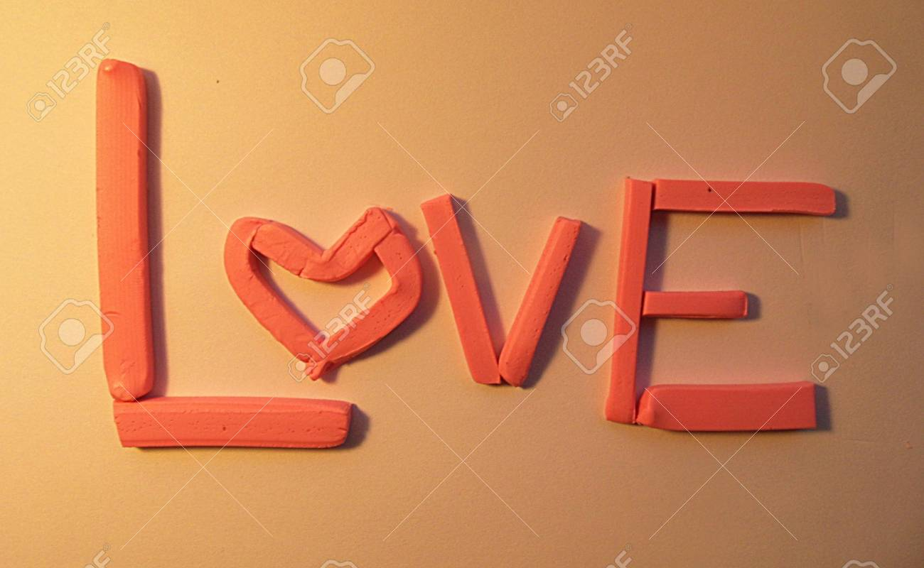 Love hand made the word love in pink modeling clay 3d love love hand made the word love in pink modeling clay 3d love word buycottarizona