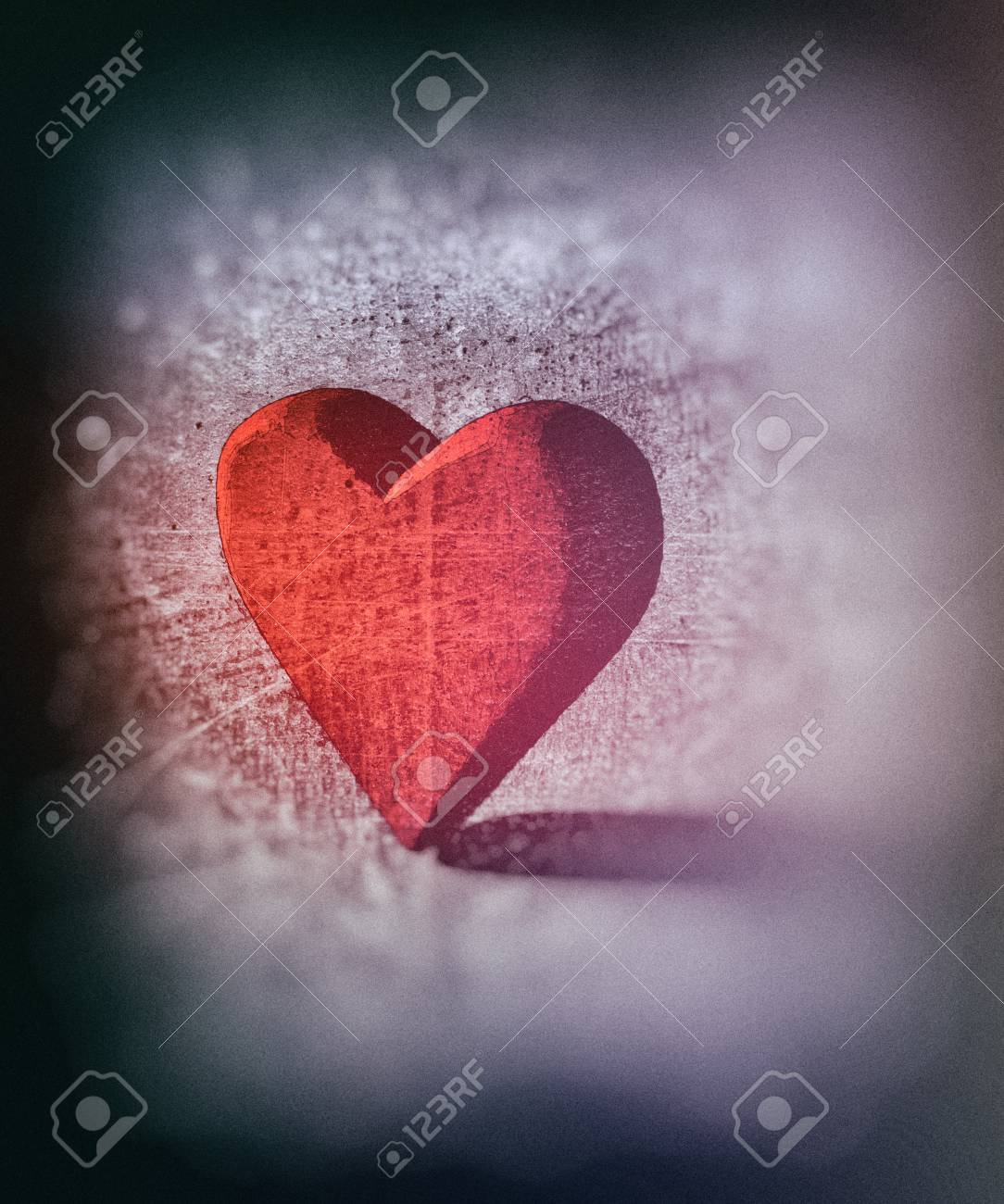 Grungy sketched red 3d heart shape lit by single with diffuse shadow colored pencil sketch style with dark blur vignette and scratches artistic heart