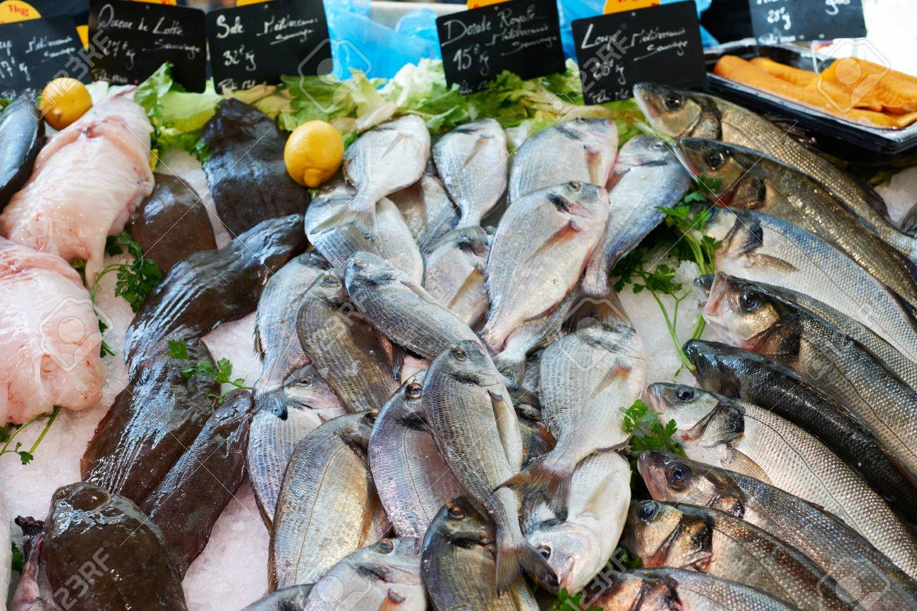 24644446-Fresh-fish-for-sale-on-sea-food-market-stall-in-Marseille-Provence-France-Stock-Photo.jpg