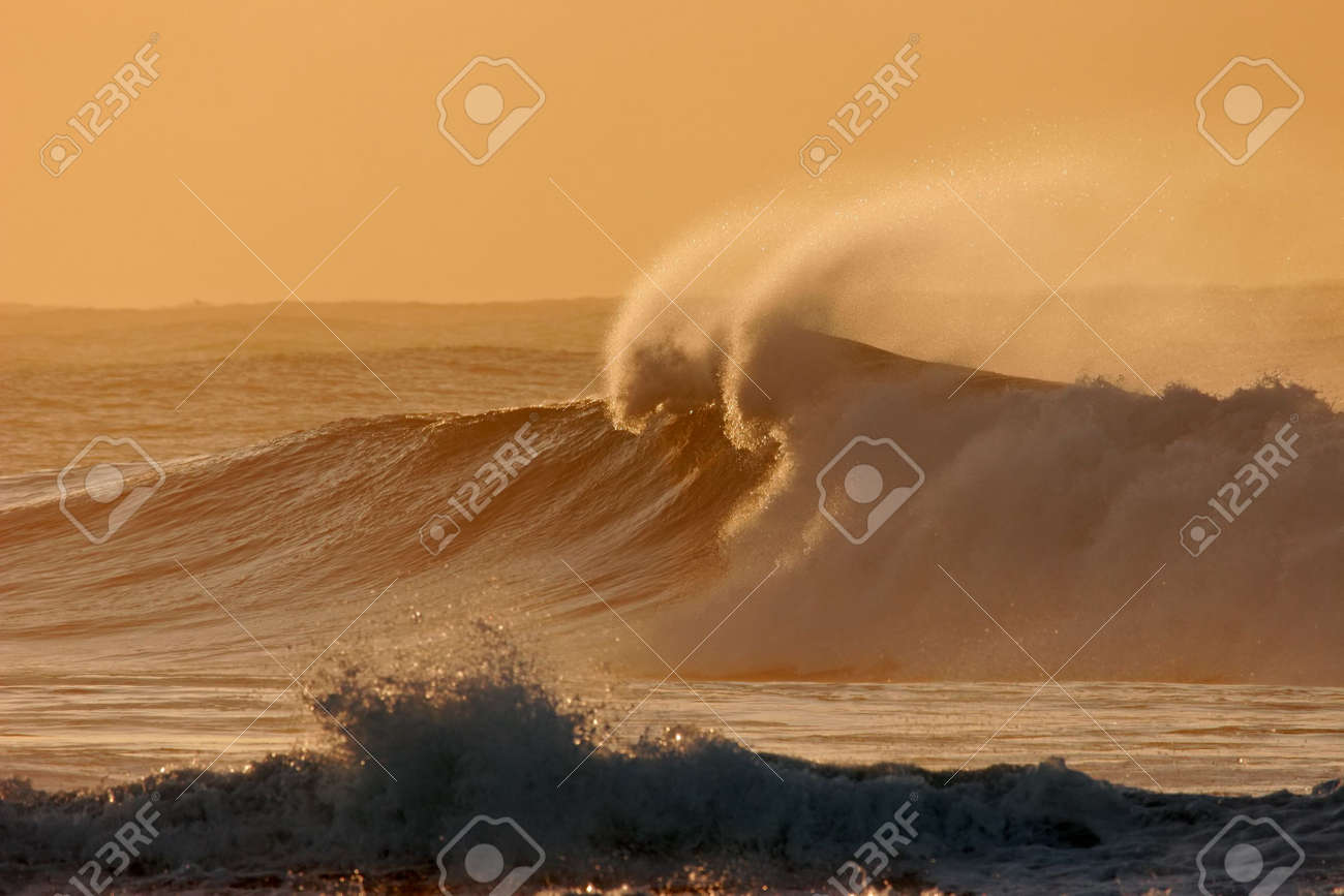 Seascape at sunset with large breaking wave Stock Photo - 1931005