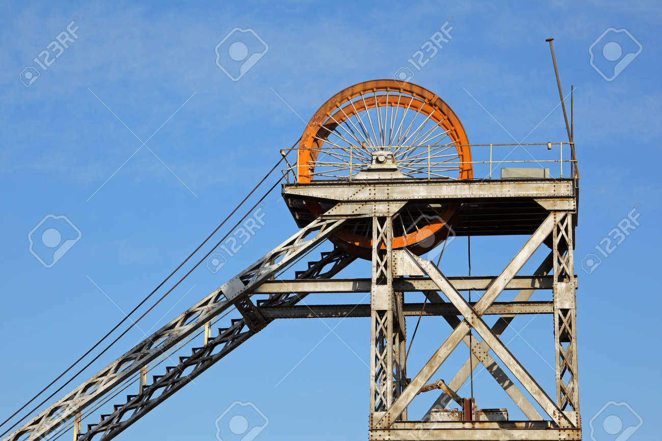 Old, disused mine shaft headgear with pulley wheel