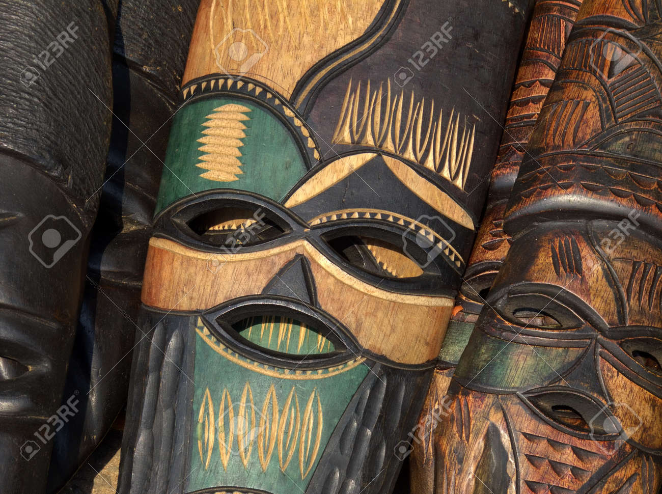 Decorated hand made wooden mask carved from the wood of an African tree - 12030011