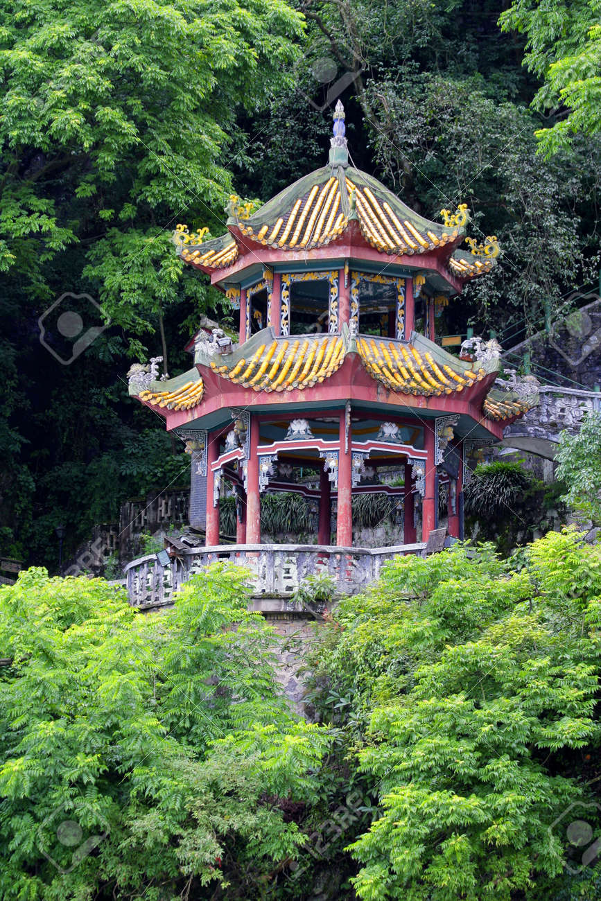 Colorful Chinese Pagoda In A Garden With Lush Green Vegetation