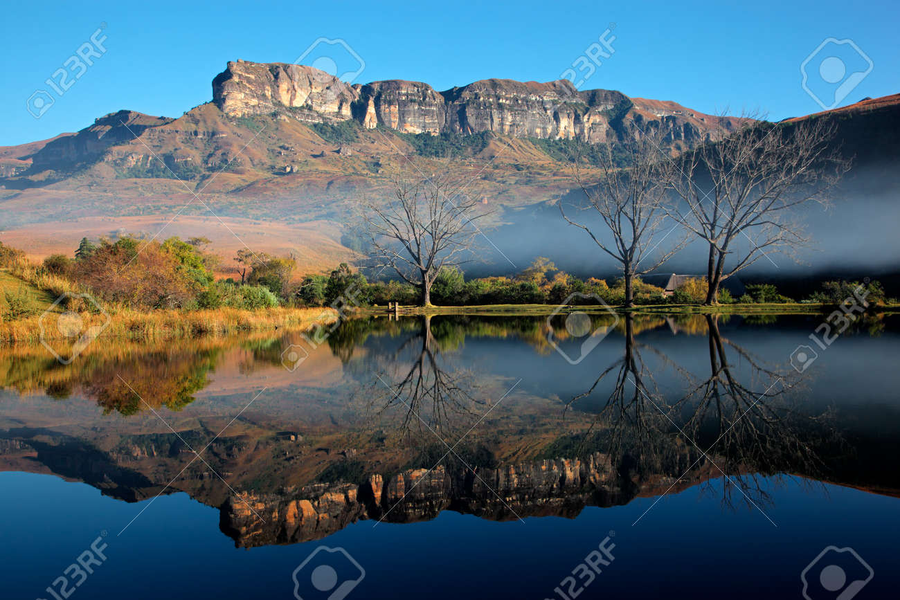 Sandstone mountains with symmetrical reflection in water, Royal Natal National Park, South Africa - 24276842