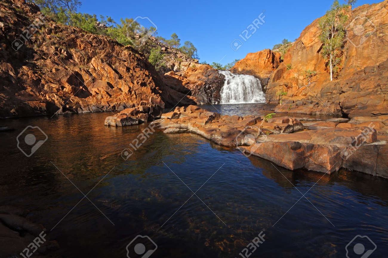 Small waterfall and pool with clear water, Kakadu National Park, Australia - 27884990