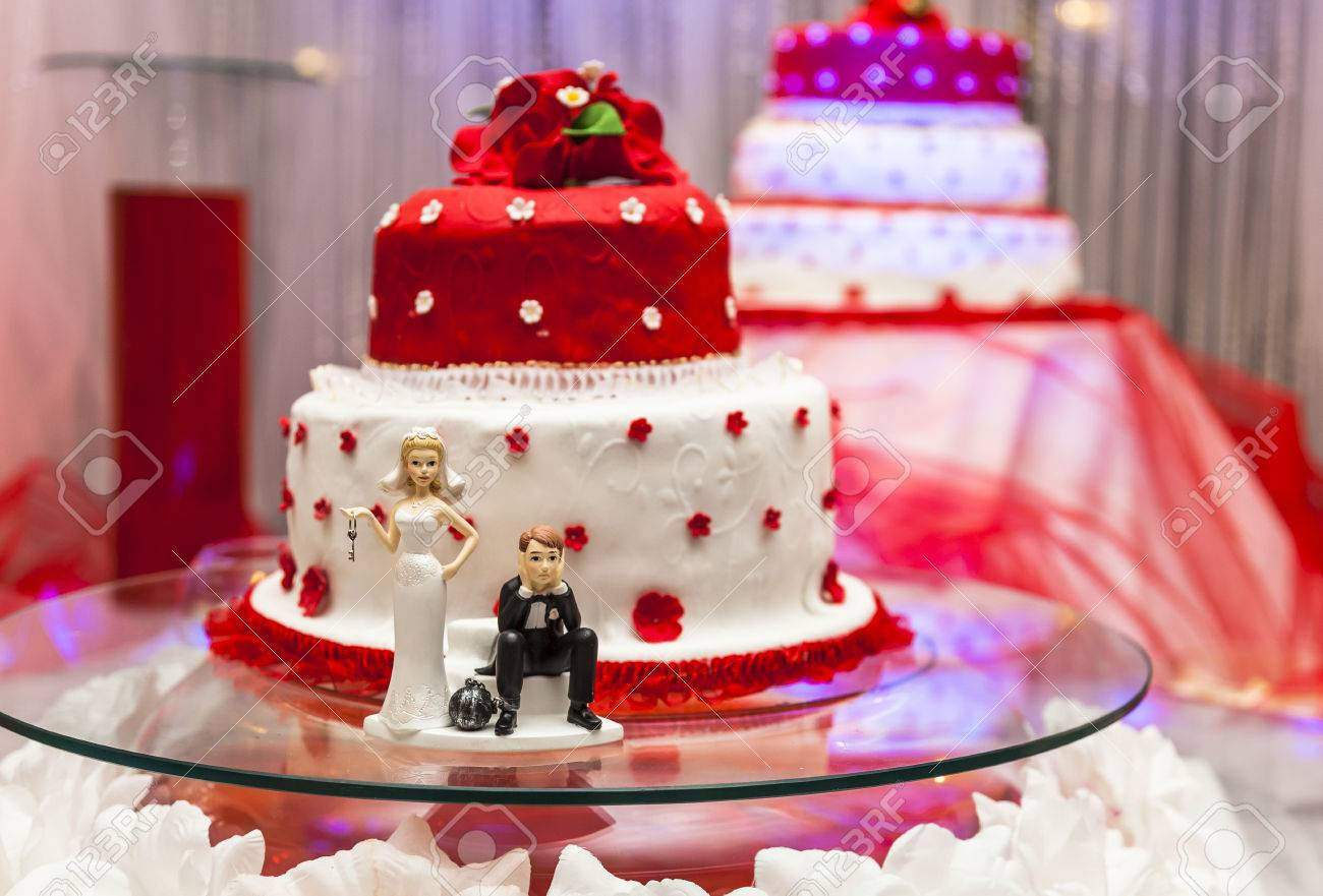 Figurines on bottom of red and white wedding cake stock photo figurines on bottom of red and white wedding cake stock photo 62191981 junglespirit Image collections