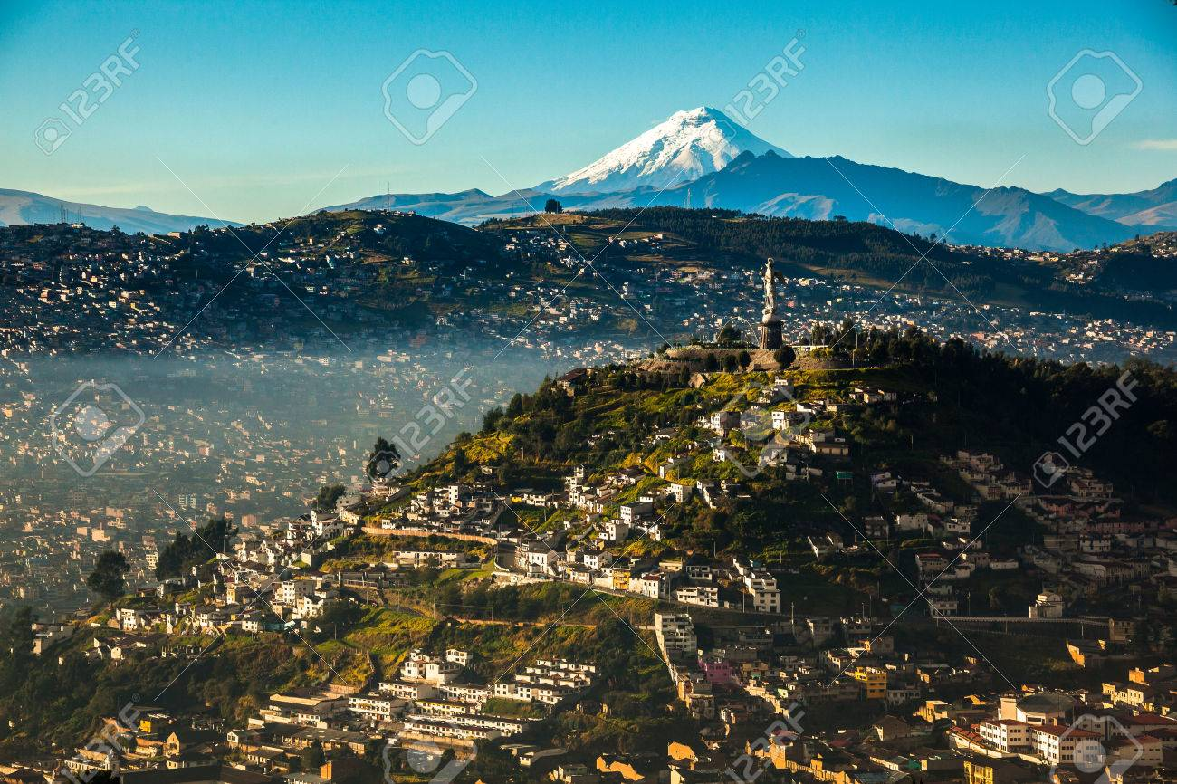 View of El Panecillo in the center of Quito with the Cotopaxi in the background - 70718127