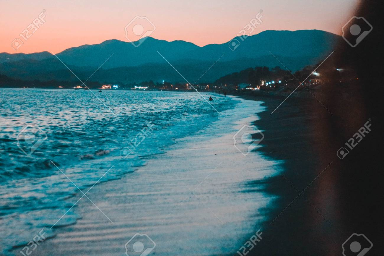 Sunset On The Beach Beautiful Sunset Under On Fethiye Beach Colorful Stock Photo Picture And Royalty Free Image Image 109691945
