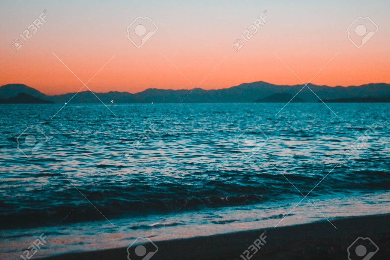 Sunset On The Beach Beautiful Sunset Under On Fethiye Beach Colorful Stock Photo Picture And Royalty Free Image Image 109691947