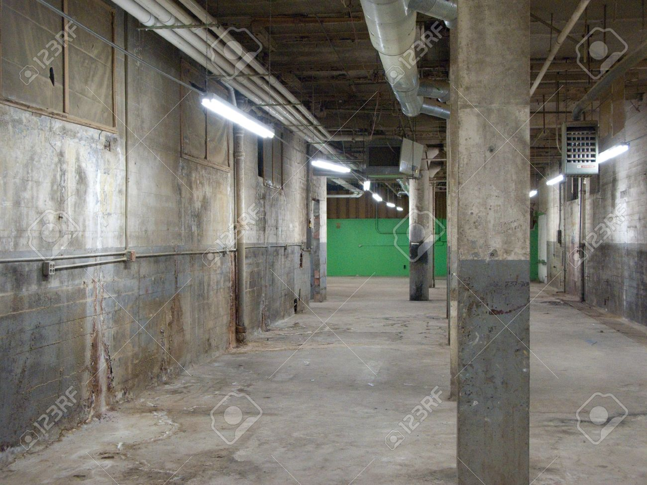 Empty older warehouse / industrial space with grey  white walls Stock Photo - 13567047