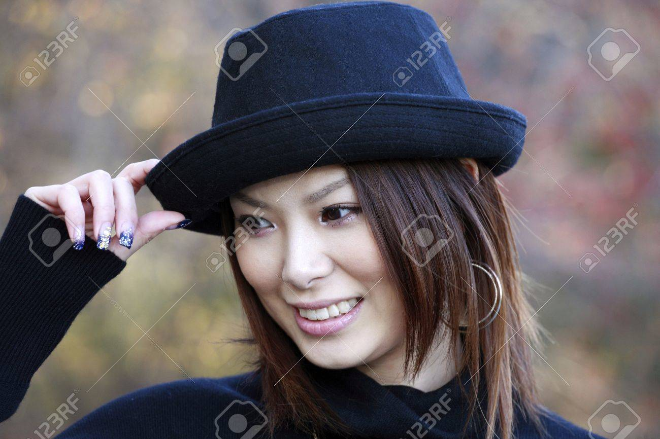 Fashion model poses in Central Park New York.  She was 23 at the time of shoot and of japanese ethnicity.  Photographed November, 2007. Stock Photo - 10328868