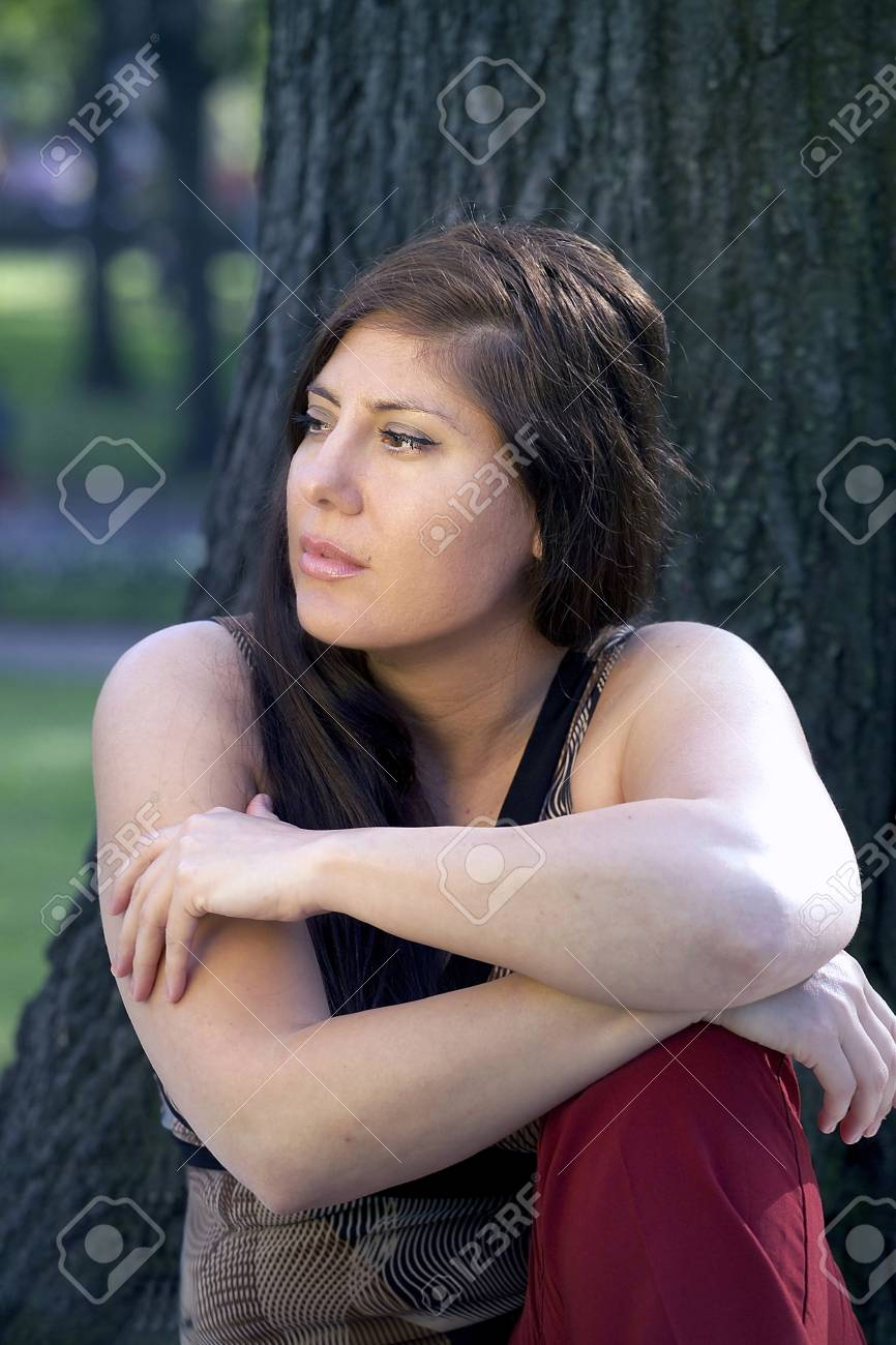 Woman sits in the park.  She was 29 at the time of shoot. Stock Photo - 10328821