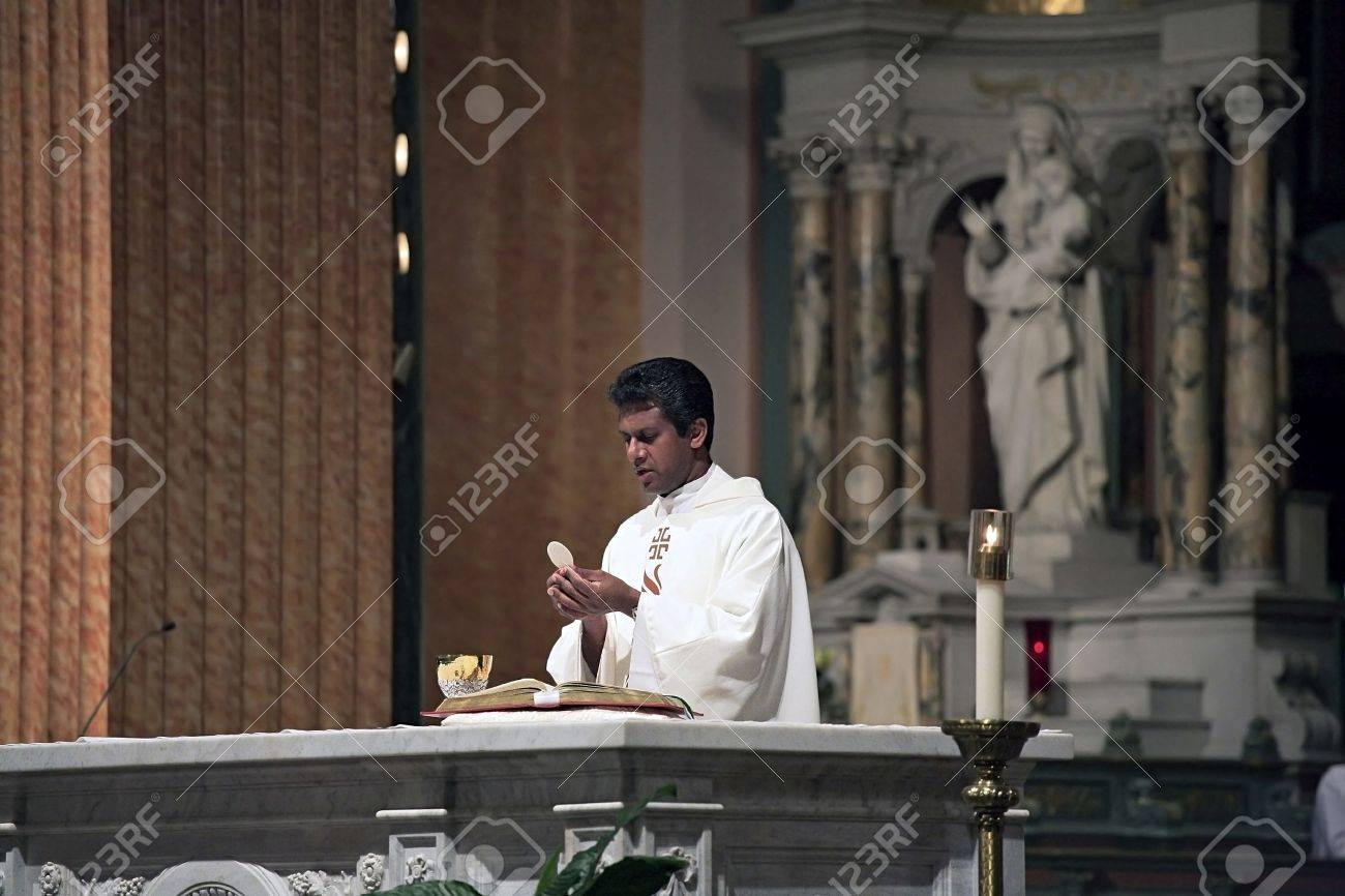 NEW YORK, NY - AUGUST 08: A priest performs the eucharistic liturgy at Saint Jean Baptiste Church.  Photographed August 08, 2008 in New York City. Stock Photo - 10339506