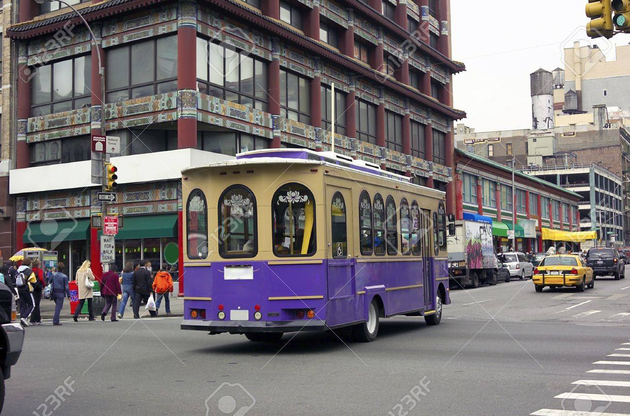 trolley car a trolley car rides downtown chinatown street in new york city