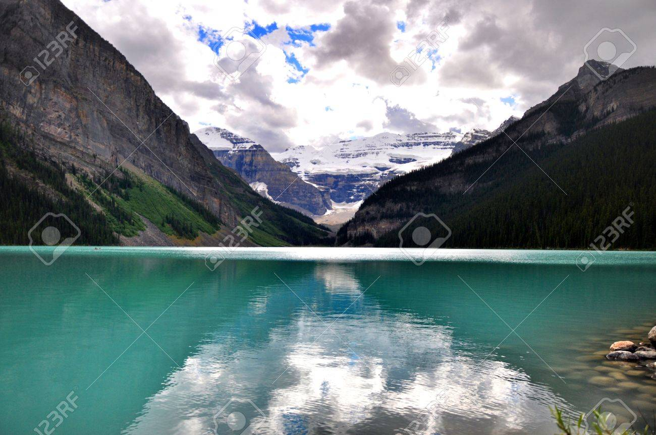Rocky mountains reflected on Lake Louise blue water Stock Photo - 11572506