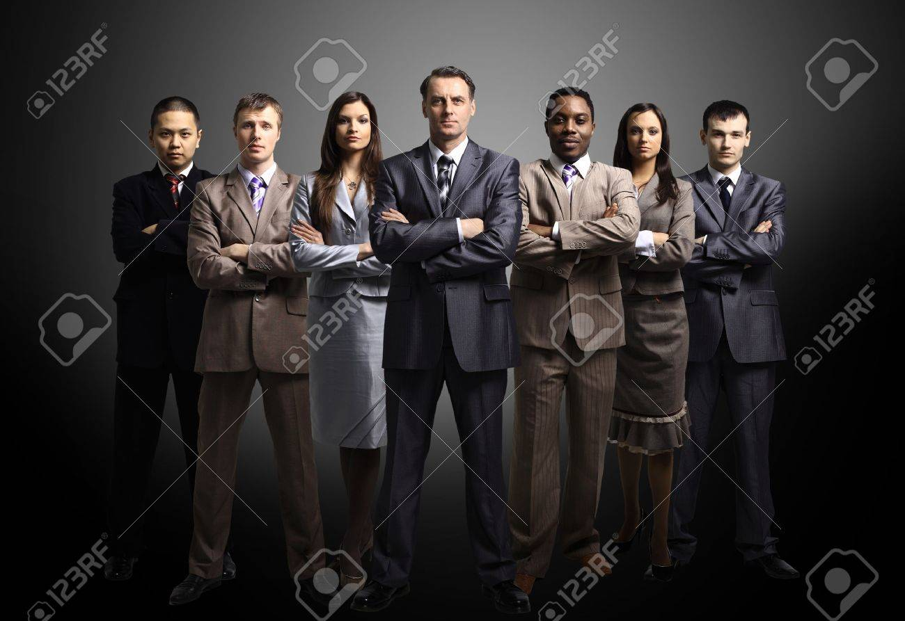 business team formed of young businessmen standing over a dark background Stock Photo - 11147934