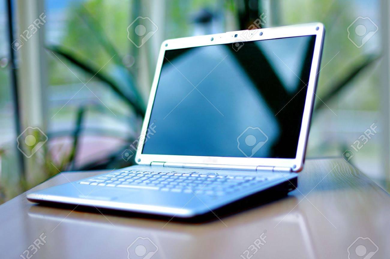 thin laptop on office desk Standard-Bild - 11211327