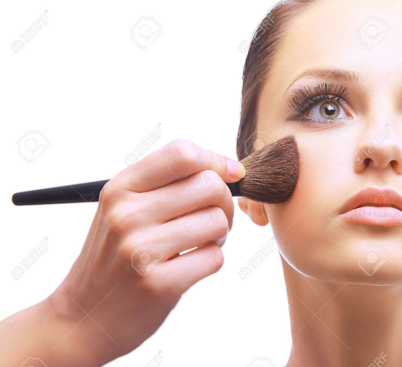 Portrait of attractive young woman applying blusher Stock Photo - 11211468