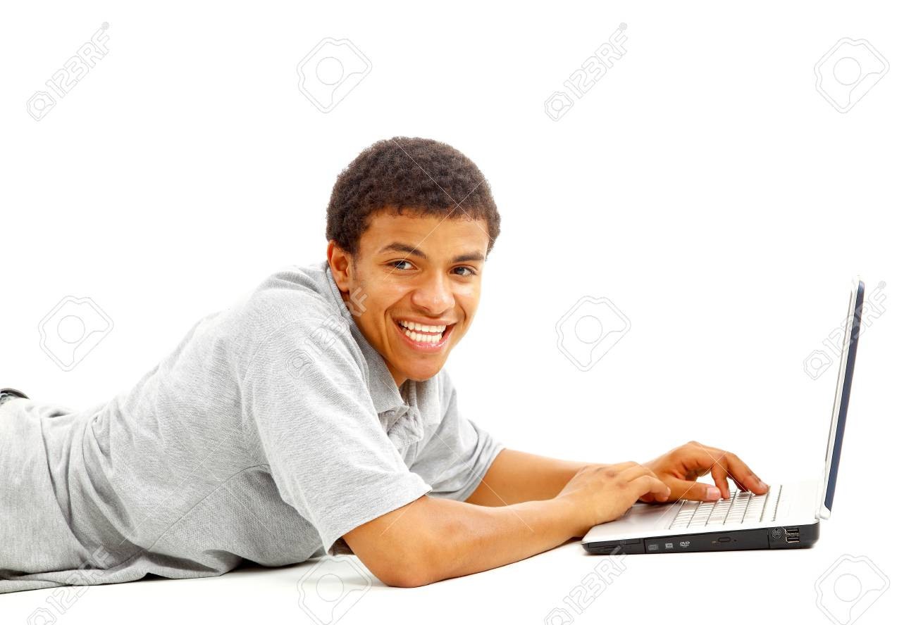 portrait of a young African American man using laptop on white background Stock Photo - 11315110