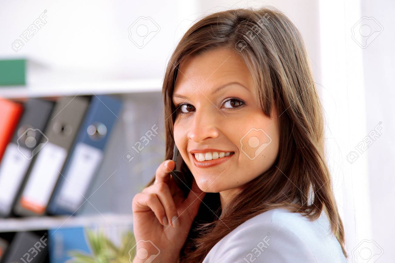 Happy woman calling on phone at home office Stock Photo - 11315139
