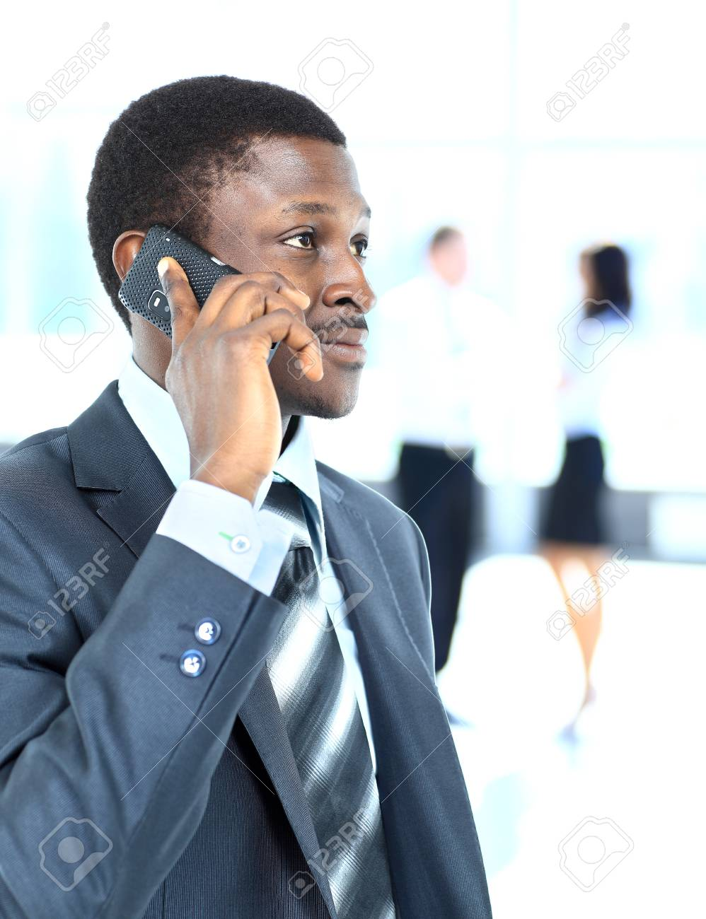 smiling businessman on the phone in his office Stock Photo - 22279036