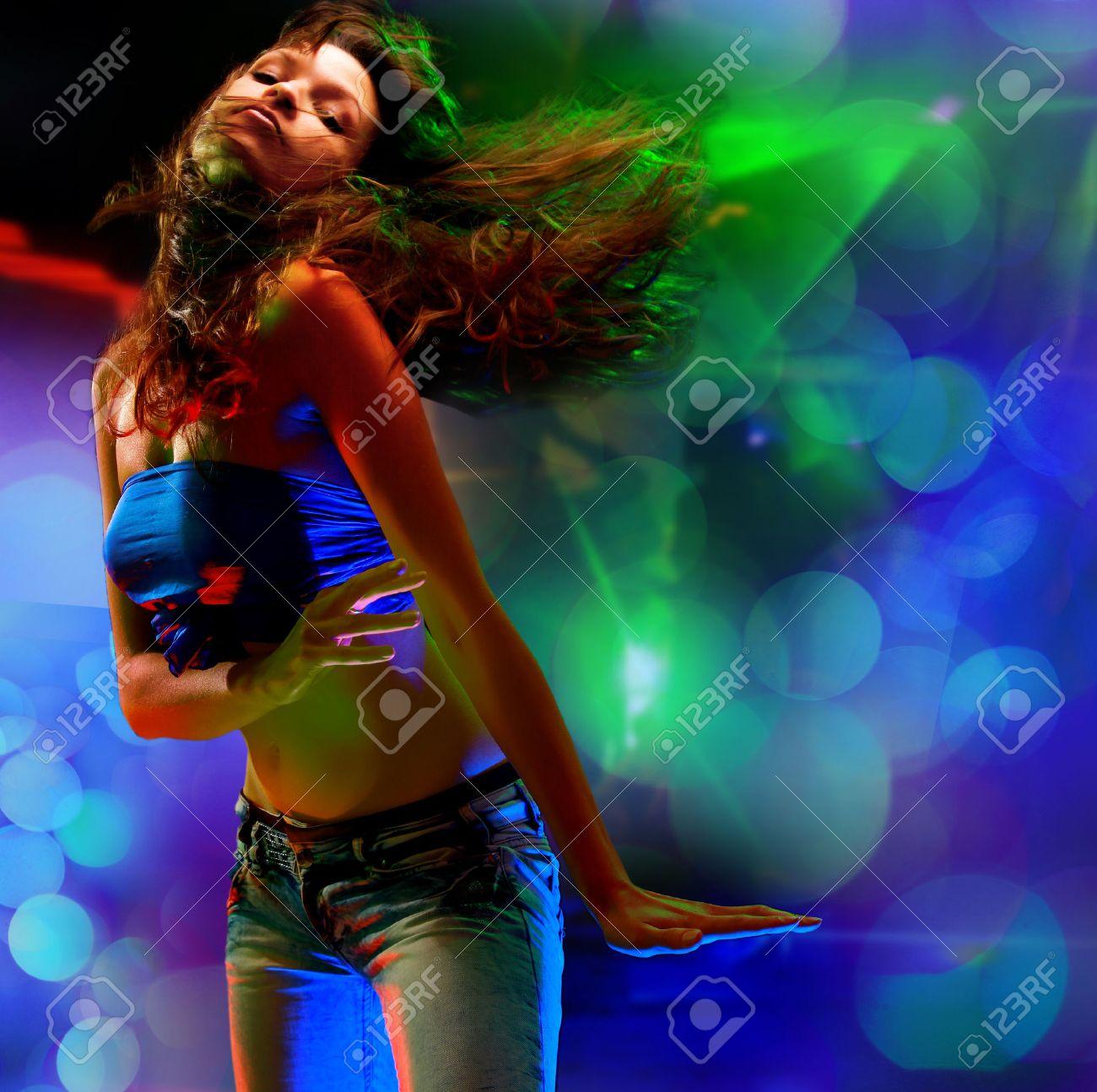 Beautiful young woman dancing in the nightclub Stock Photo - 22308676