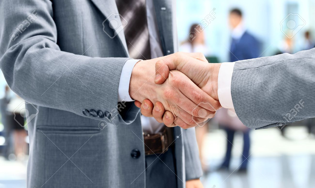 Business people handshake greeting deal at work photo free download - Handshake In Front Of Business People Stock Photo 22400358