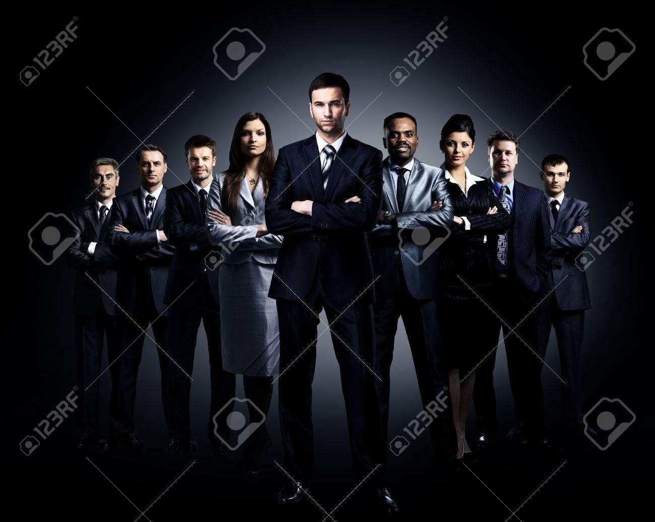 business team standing over a dark background Standard-Bild - 29170013