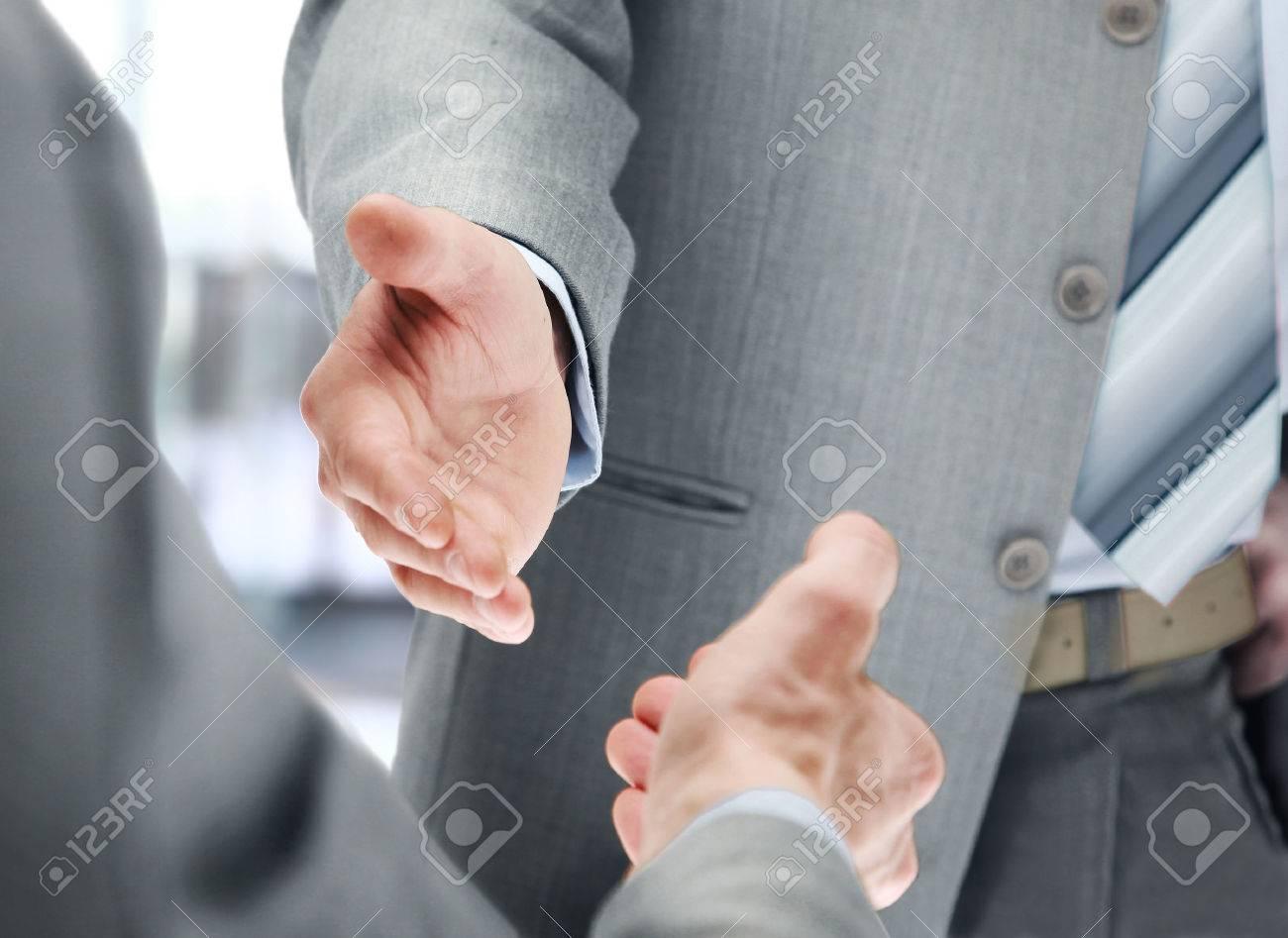 Close up of businessmen shaking hands Standard-Bild - 29170006