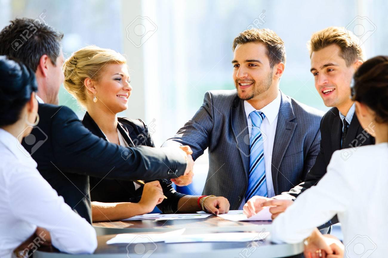 Two businessmen handshaking after striking grand deal Standard-Bild - 34313809