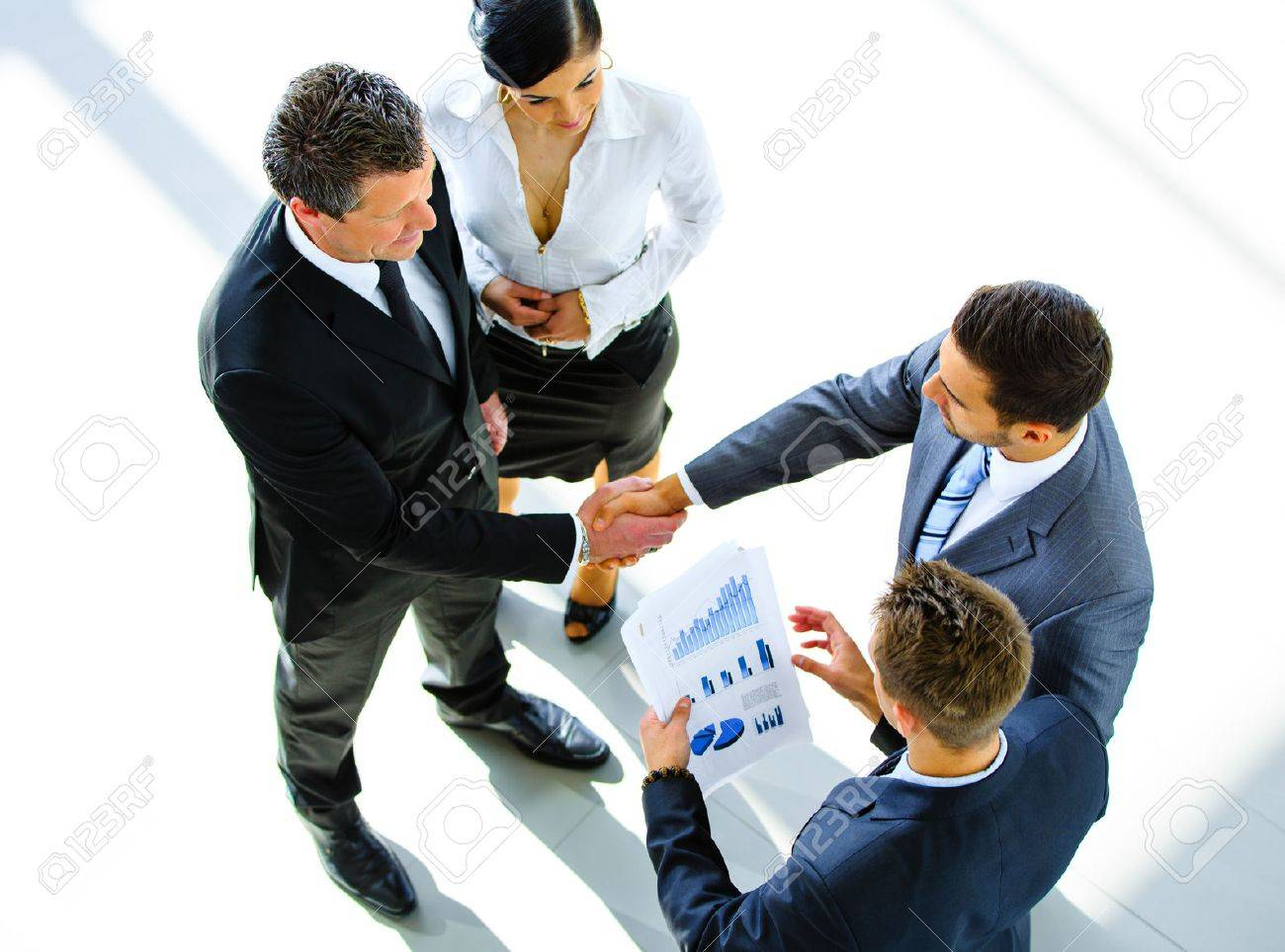 Top view of a two businessman shaking hands - Welcome to business Standard-Bild - 34323977
