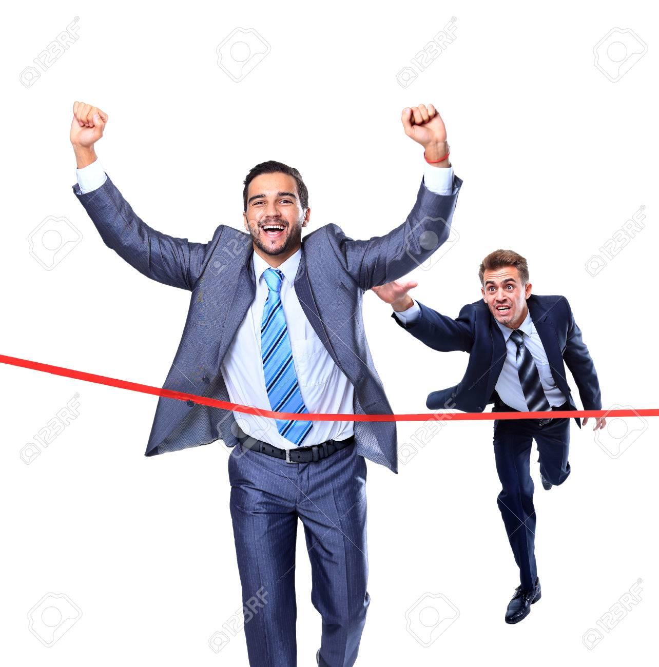 Happy businessman running through finishing line. Isolated on white Standard-Bild - 34324016