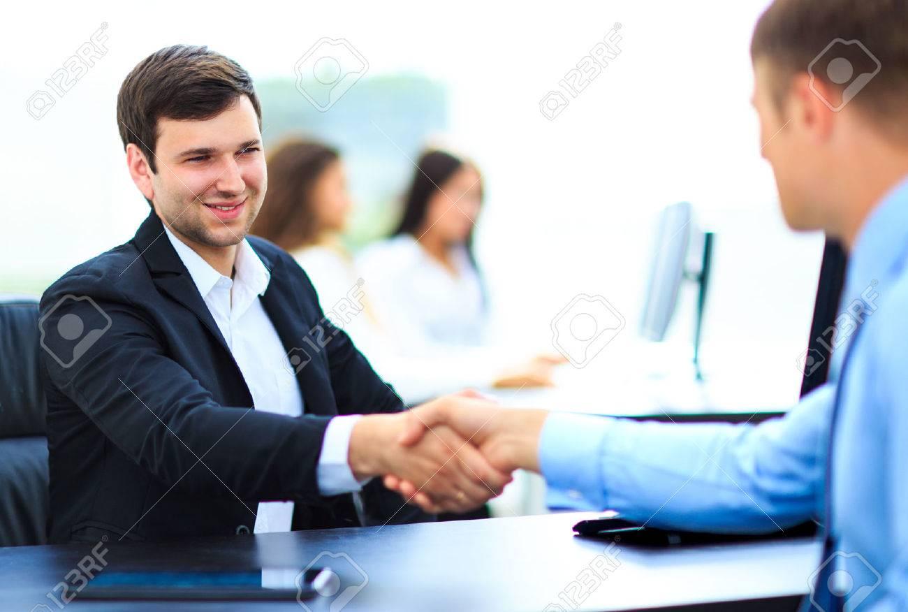 Salesman shaking hands to clients Standard-Bild - 46275691
