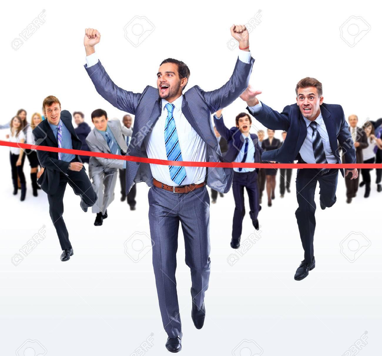 Happy businessman running through finishing line Standard-Bild - 48337105