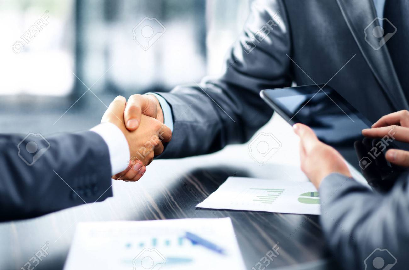 Business people shaking hands Stock Photo - 49572474