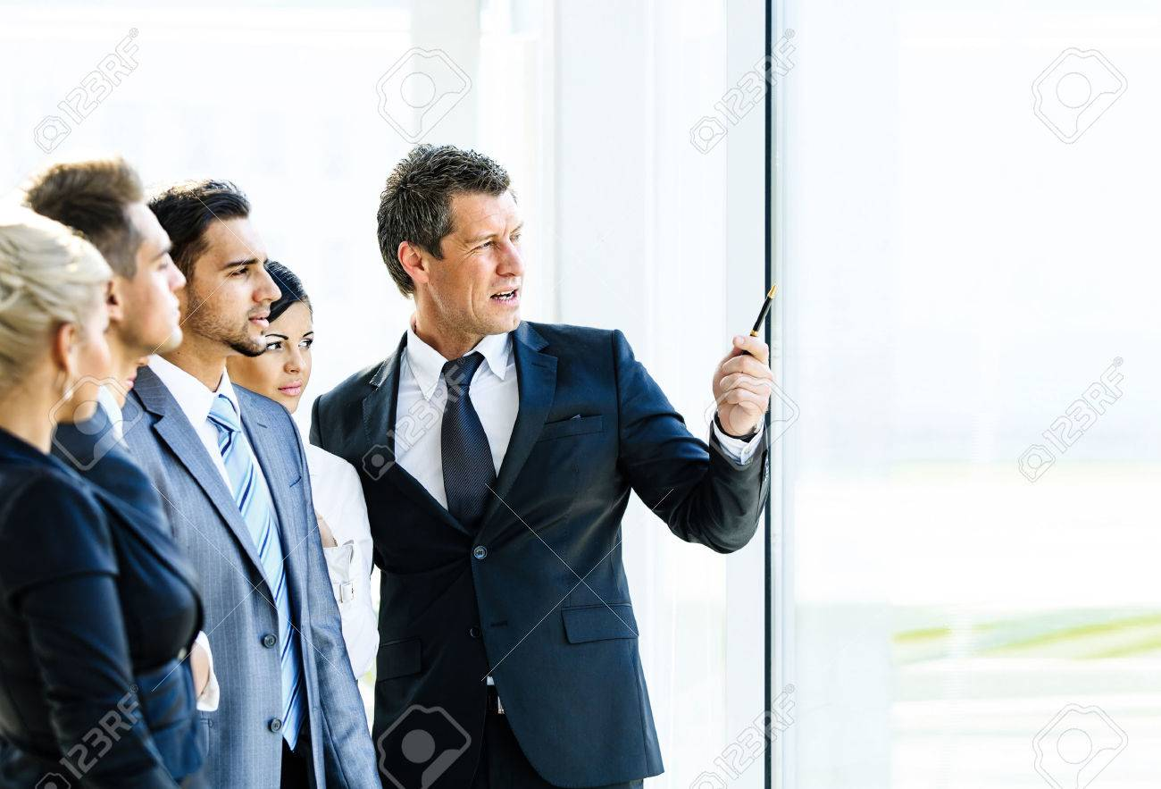 Business seminar where a boss explaining the company strategy to his colleagues Standard-Bild - 49499961