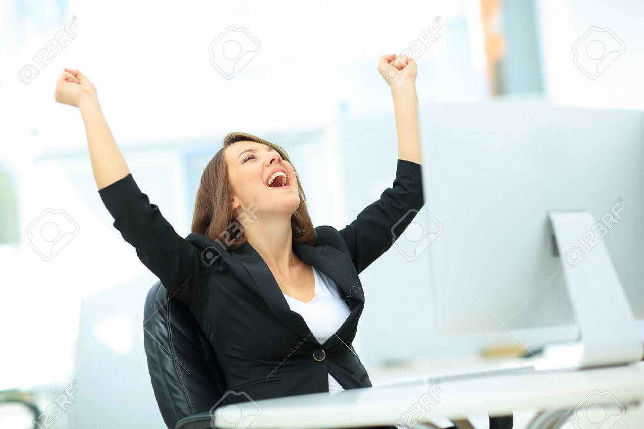 Portrait of happy young successful businesswoman celebrate something with arms up Standard-Bild - 60567923