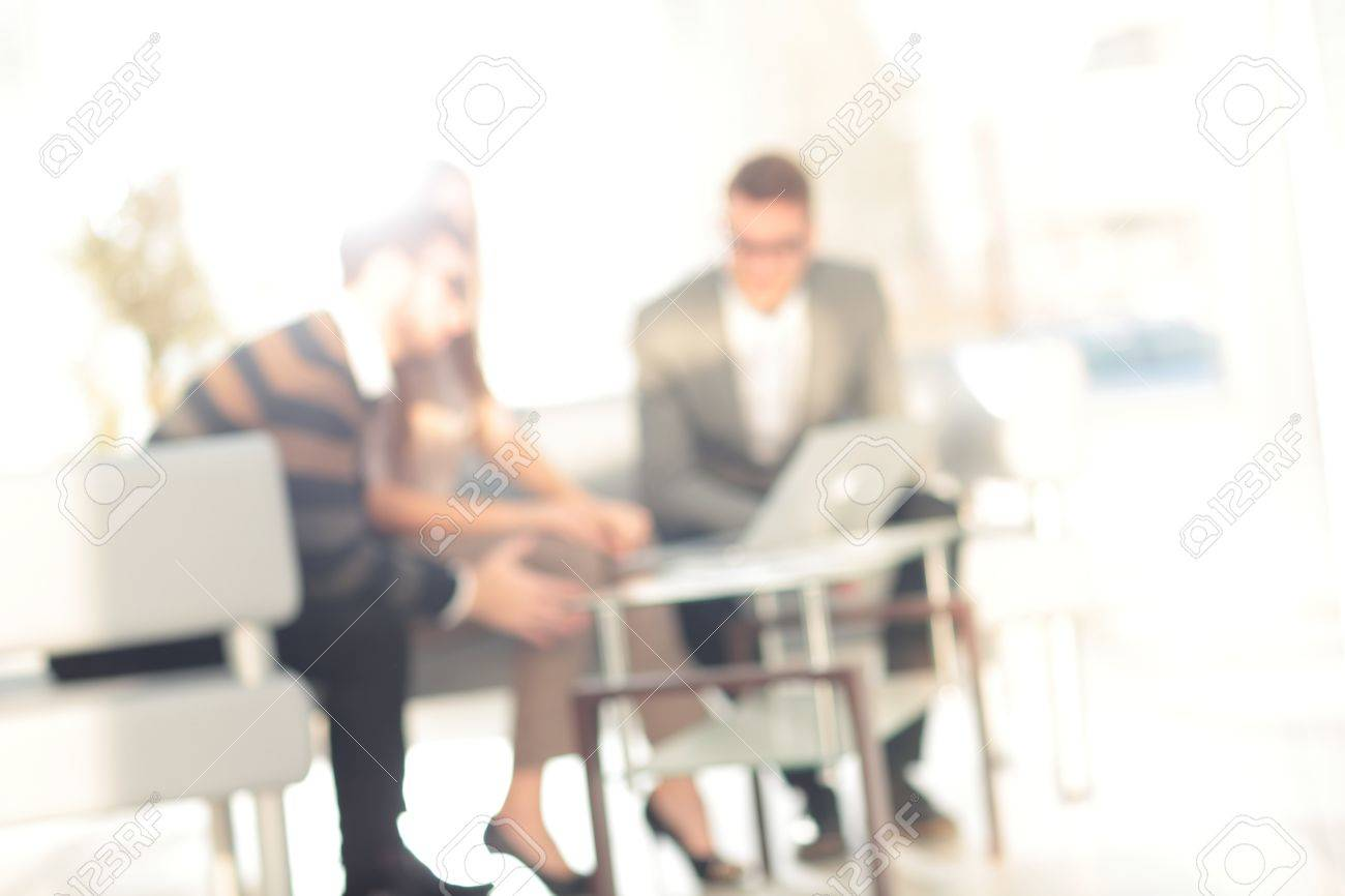 Blurred abstract background of business discussion people group. Blurry view inside office interior Standard-Bild - 66015799