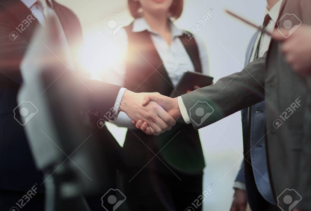 business handshake in modern office - 67468508