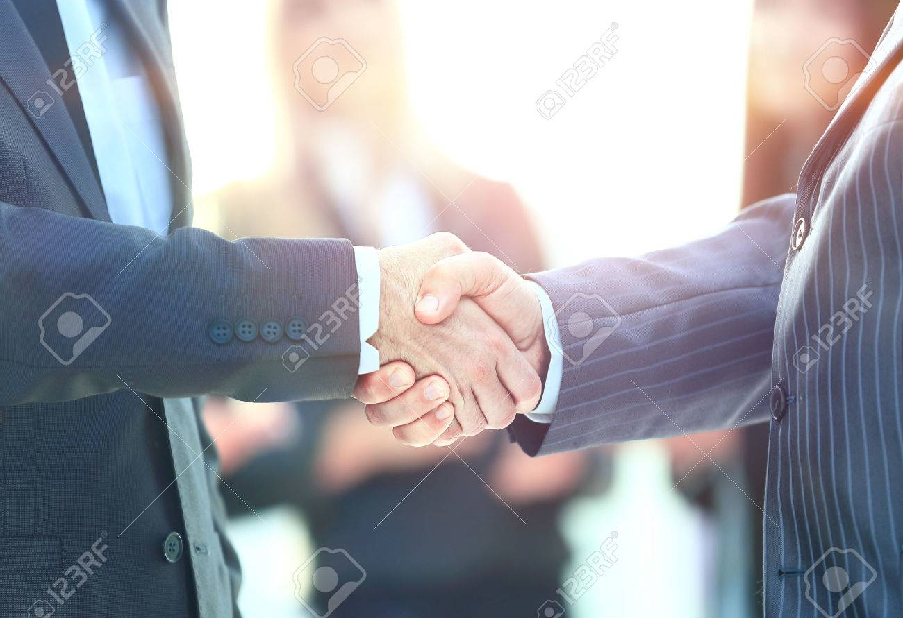 Business handshake. Business man giving a handshake to close the deal - 67469155