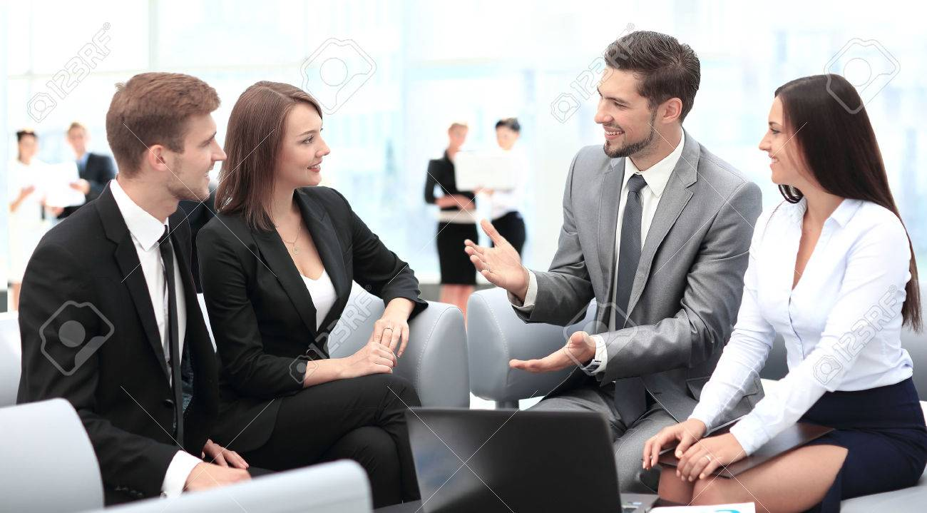 Happy business people talking on meeting at office - 67471849