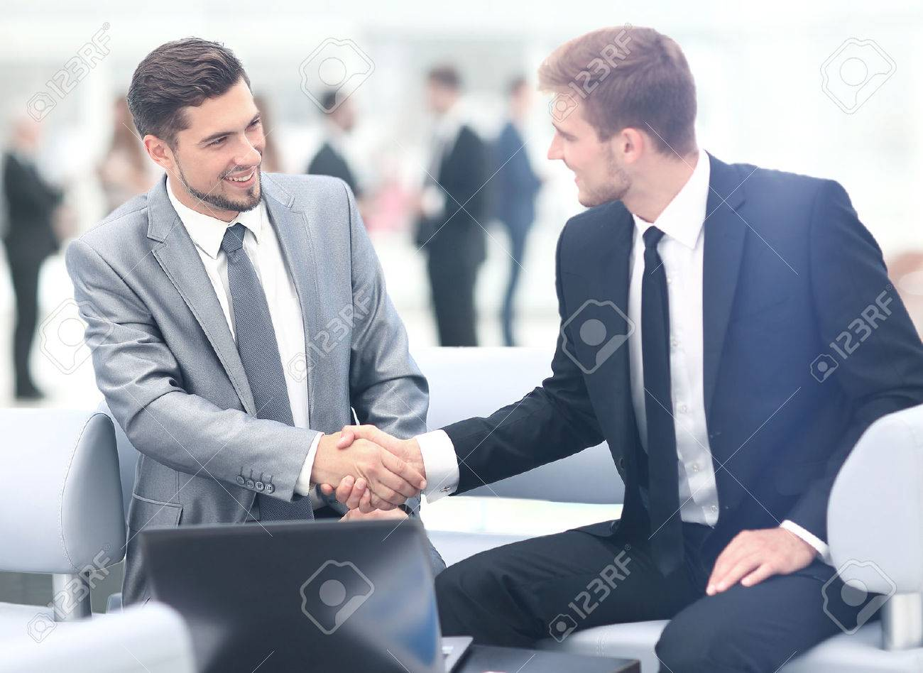 Business people shaking hands during a meeting Standard-Bild - 67471854