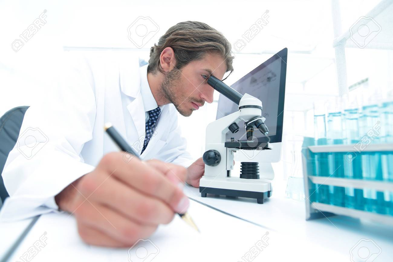 scientist makes a note of experiment in the laboratory - 88791171
