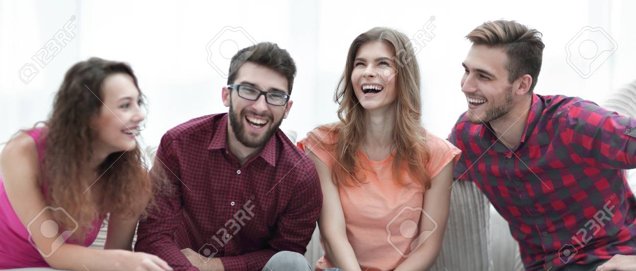 group of cheerful young people sitting on the couch. - 91166070