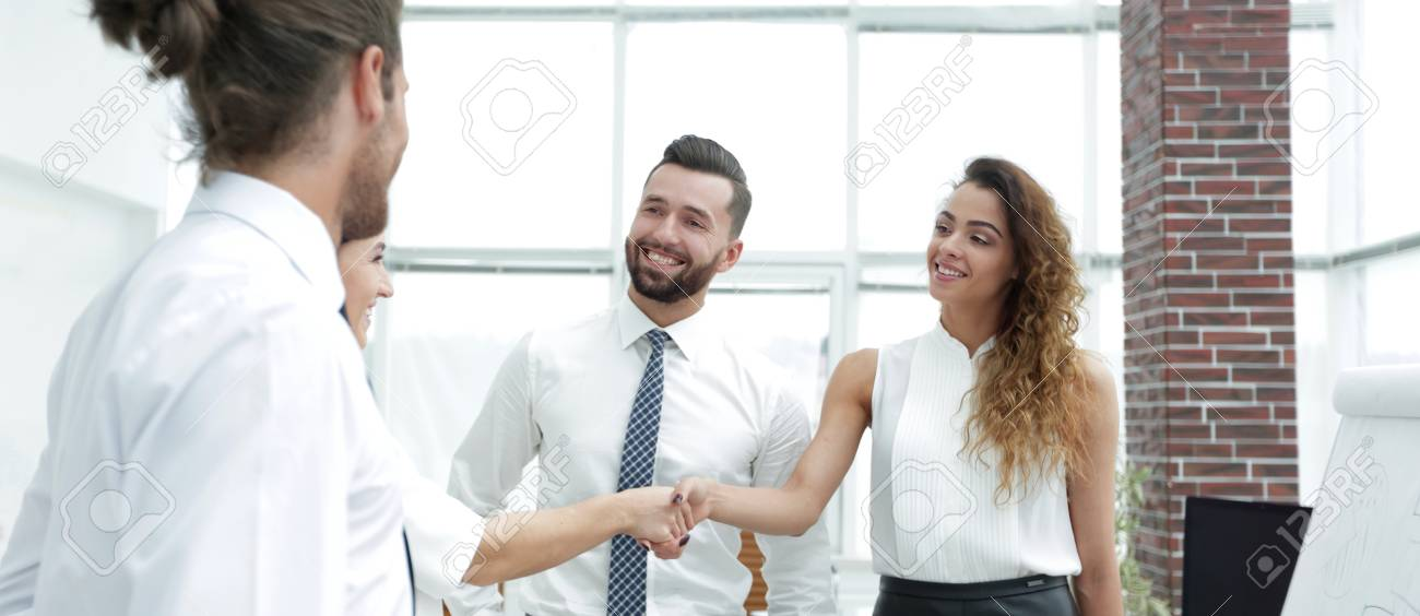 business women greet each other with a handshake - 91581197