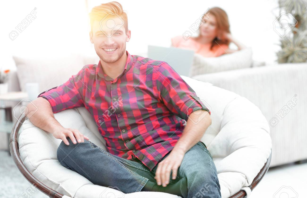 Modern Young Man Sitting In A Big Round Chair On Blurred Background Stock Photo Picture And Royalty Free Image Image 95876906