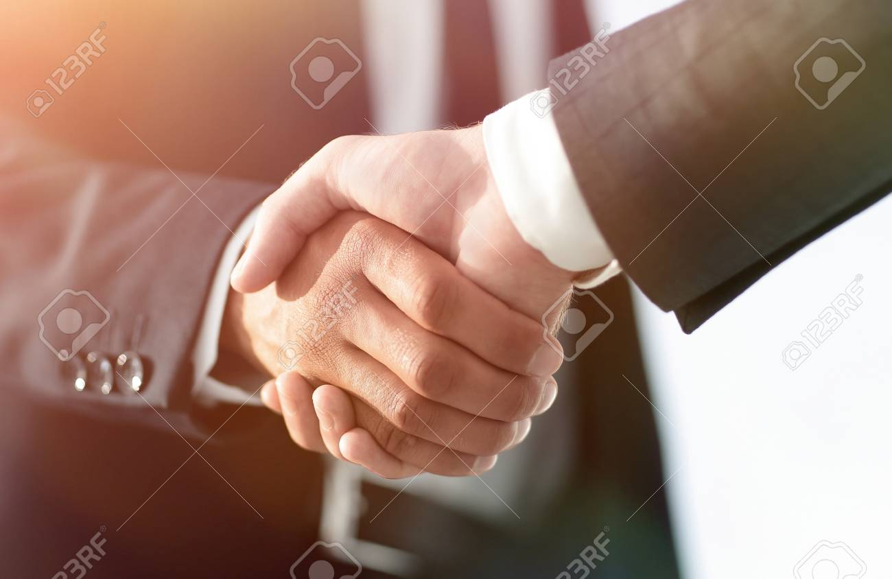 Business men giving a handshake. Business concept - 103576184