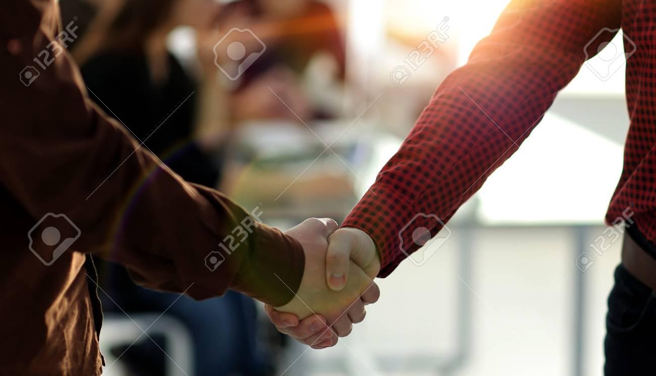 closeup of handshake between two men i - 112260869