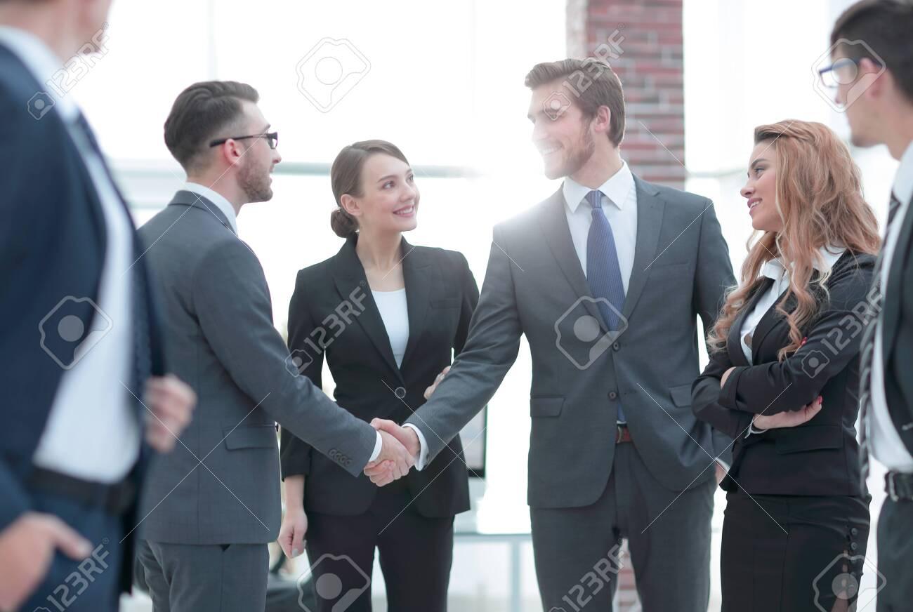 business handshake of businessmen in the office - 120517301