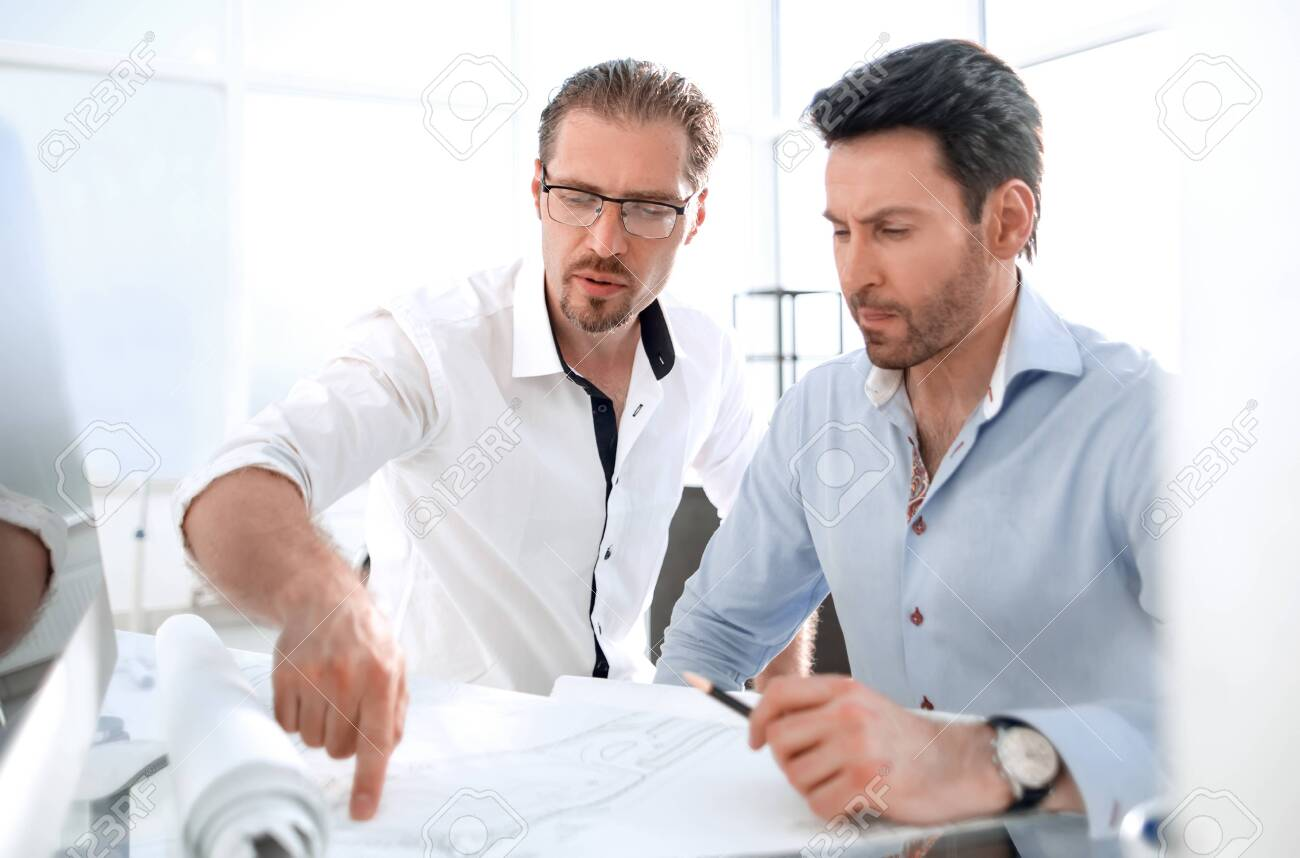 two architects discussing the project in the office - 128287216